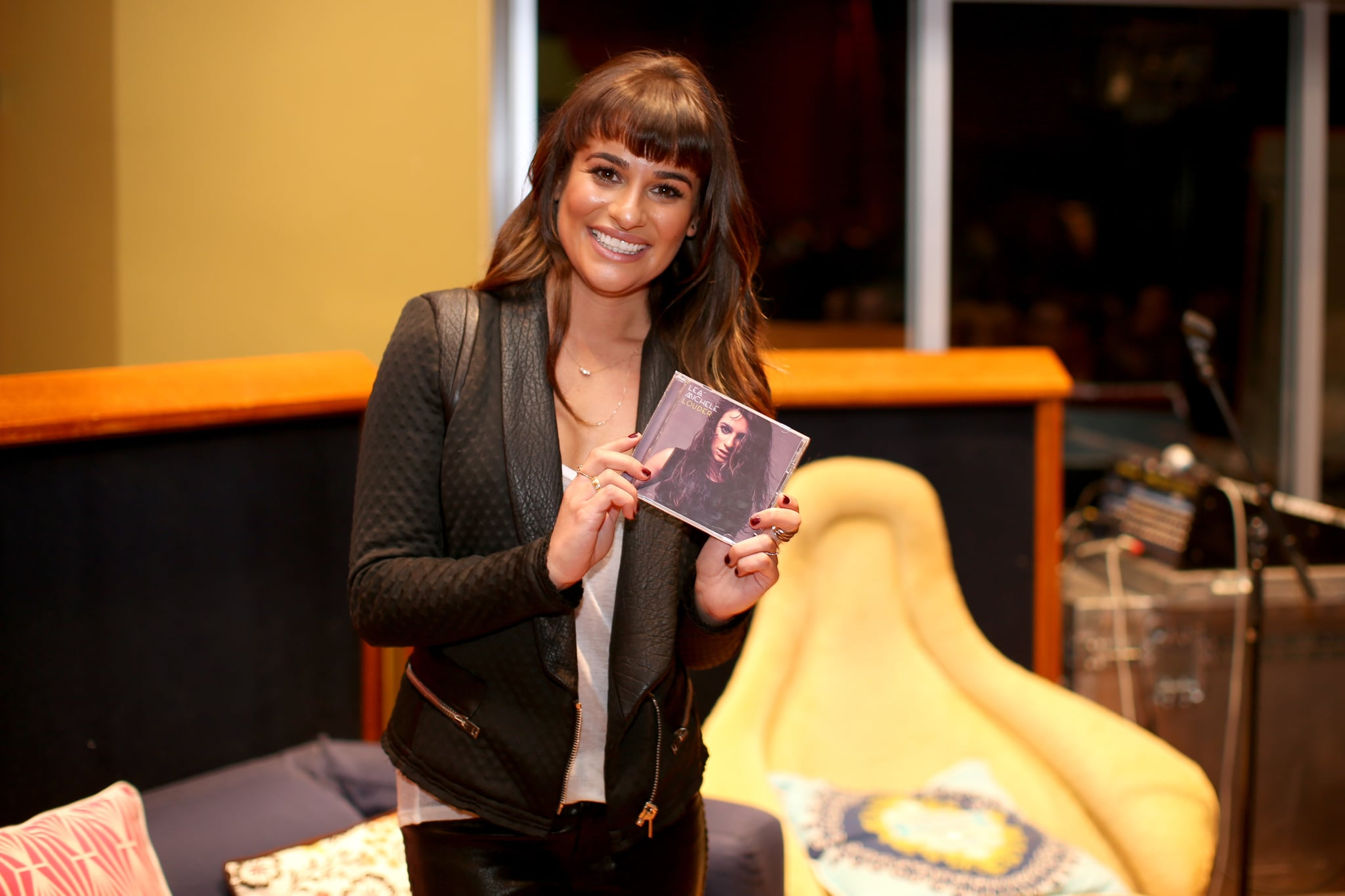 The singer held up her album cover.