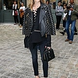 Olivia Wore an Embellished Leather Jacket With a Lace-Up Top, Jeans, and Pumps