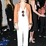 Zosia later wore a white jumpsuit and fringed jacket to Rebecca Minkoff.