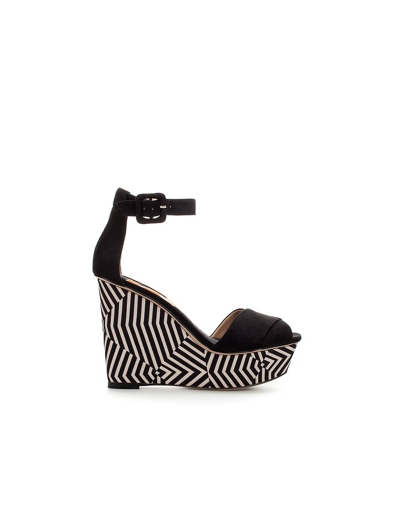 Spice up a Summer LWD with these fun, printed wedges. The graphic black-and-white pattern adds depth, and the ankle strap keeps you sturdy on your feet. Zara Printed Platform Wedge ($90)