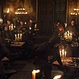 Two rows of candlelit banquet tables at the Red Wedding Revenge
