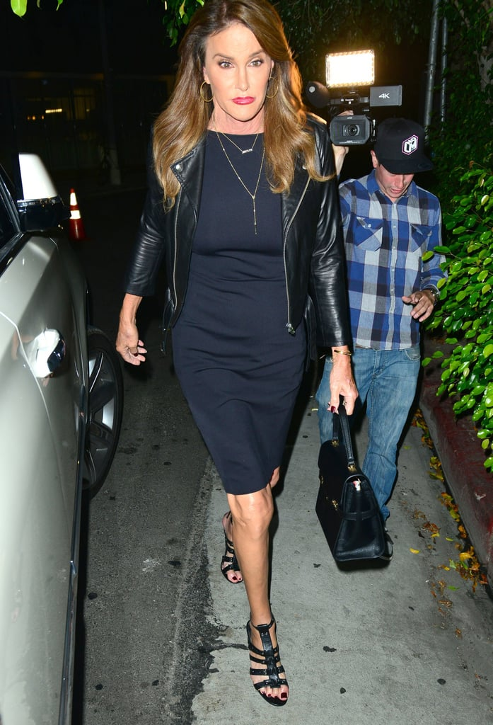 Caitlyn Jenner Looked Edgy-Chic in a Black Knee-Length Dress, Leather Jacket, and Hoop Earrings