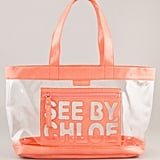 We'd carry this clear tote to the farmers market, the beach, and beyond.  See by Chloé Zipfile Tote ($225)