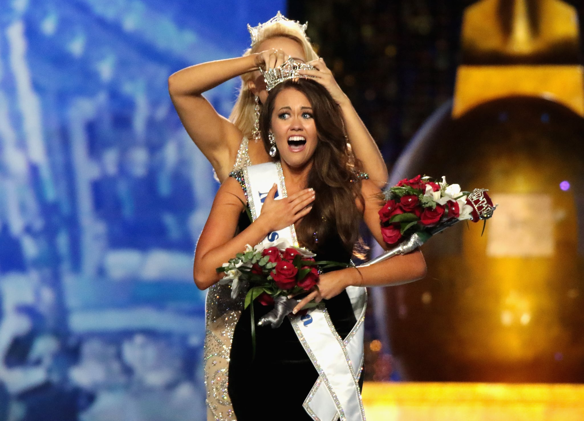 ATLANTIC CITY, NJ - SEPTEMBER 10:  Miss North Dakota 2017 Cara Mund is crowned as Miss America 2018 by Miss America 2017 Savvy Shields during the 2018 Miss America Competition Show at Boardwalk Hall Arena on September 10, 2017 in Atlantic City, New Jersey.  (Photo by Donald Kravitz/Getty Images for Dick Clark Productions)