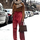 Style a Cozy Sweater and High-Waisted Pants With a Chunky Plaid Scarf