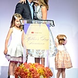 Jessica and Cash snuck in a kiss at the Helping Hand of Los Angeles Mother's Day Luncheon in 2014.