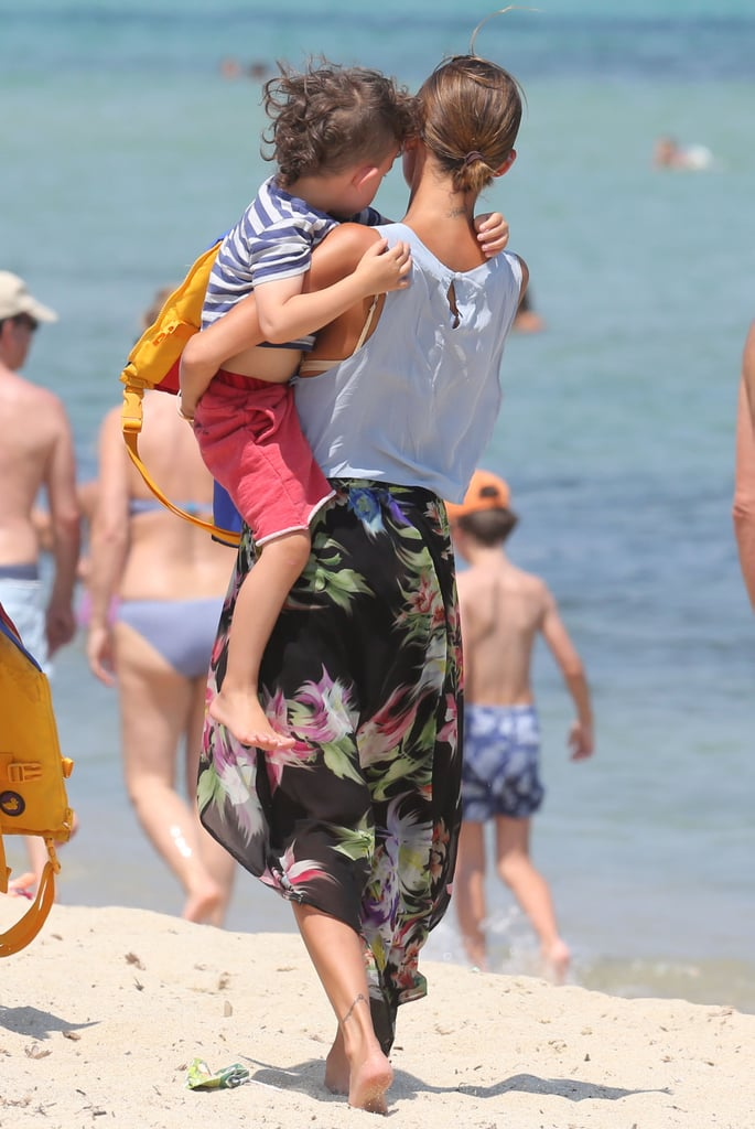 Nicole Richie carried her son, Sparrow Madden, on the beach in the South of France.