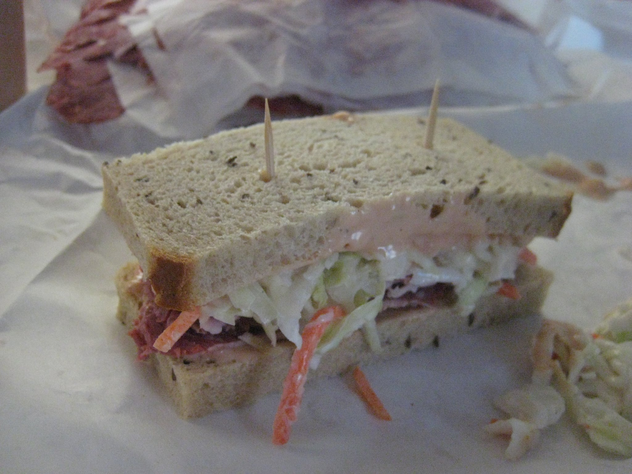 Top with the remaining slice of bread. If desired, to make the messy sandwich easier to eat, stab with two toothpicks.