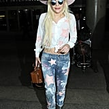 Wearing a star-embellished ensemble with a pink hat.