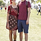 We're feeling the matching red tones on this Coachella couple.