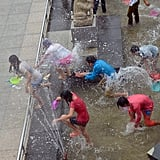 Kids and tourists played in the water during the Hainan Qixian Hotspring Water Festival, a celebration of the Chinese Valentine's Day.