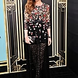 Isla Fisher opted for a dark floral-embellished look by Dolce & Gabbana paired with a black Roger Vivier Pilgrim clutch.