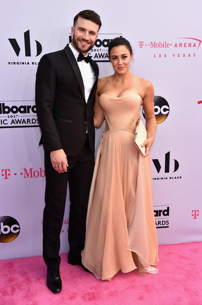 """Sam Hunt had his wife by his side at the Billboard Music Awards in Las Vegas on Sunday. The country singer recently tied the knot with Hannah Lee Fowler, and he gushed about being a married man when he chatted with E! on the red carpet. """"She's beautiful, isn't she?"""" he said. With a nod to his wedding band, he added, """"There's a spiritual strength to it, and I feel a little bit taller now that I'm wearing it."""" The couple's first red carpet appearance at the Billboard Music Awards came just weeks after he serenaded his other half at the ACM Awards. She blushed as he performed """"Body Like a Back Road"""" with his arm around her, prompting fans everywhere to swoon. File under: yet another reason to love him."""