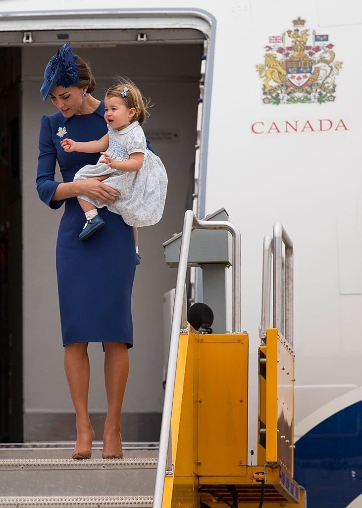 Kate touched down in Canada looking impeccably polished in a blue sheath Jenny Packham dress and coordinating Sylvia Fletcher fascinator.