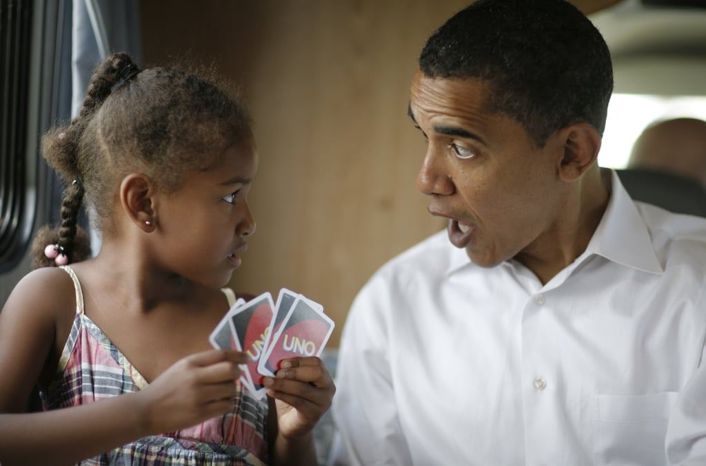 Sasha and her dad, then just a presidential candidate, played cards on July 4, 2007.