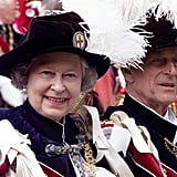 Queen Elizabeth II and Prince Philip leave a Garter ceremony in 1999.