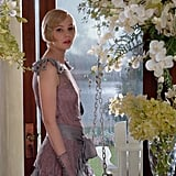 Carey Mulligan shows off one of Daisy Buchanan's day looks — a soft, flowy dress adorned with ruffles at the sleeves.