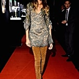 Joan Smalls paired a minidress with dramatic over-the-knee boots for the Bulgari fete.