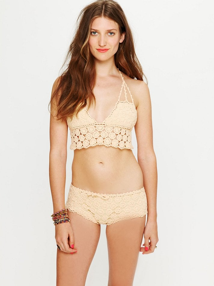 This cream-colored crochet suit is equals parts sweet and sexy — wear it with a floaty top and white jeans for a cool vacation look. Free People Daisy Crochet Bikini Top ($88) and Swim Shorts ($78)
