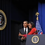 Michelle hugged Obama tight during an event.