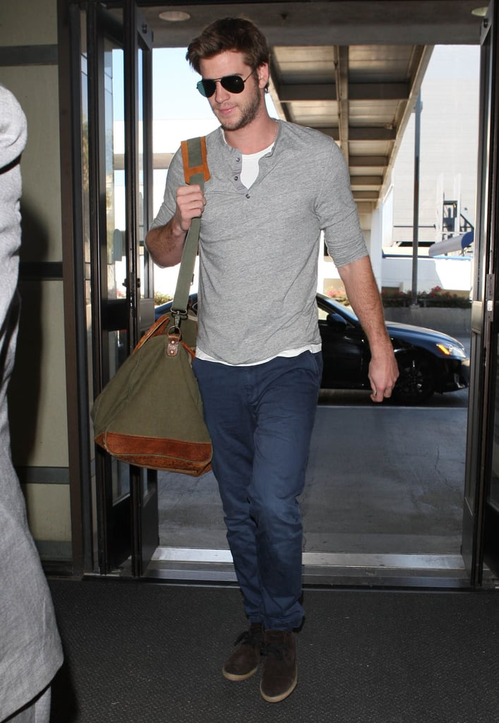 Liam Hemsworth caught a flight out of LAX yesterday. He was on the go after spending a few weeks on the West Coast with his bride-to-be, Miley Cyrus. Liam and Miley Cyrus were together for lots of quality fiancé time, which they spent on Starbucks runs or chilling at her California home. Despite wanting to be with Liam, Miley also had to log long hours in the music studio. She shared a photo of herself hard at work earlier this week with Pharrell Williams and Tyler, the Creator. Liam stayed busy, too, and stepped out solo for a party celebrating the launch of Samsung's new Galaxy Note II last Thursday. He's jetted in and out of California over the last few months during a break from shooting Catching Fire in Atlanta. His costars Jennifer Lawrence and Josh Hutcherson were off recently, but soon they'll all be required back in Georgia.