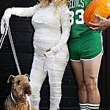 Jessica Simpson and Eric Johnson pose in their Halloween costumes.