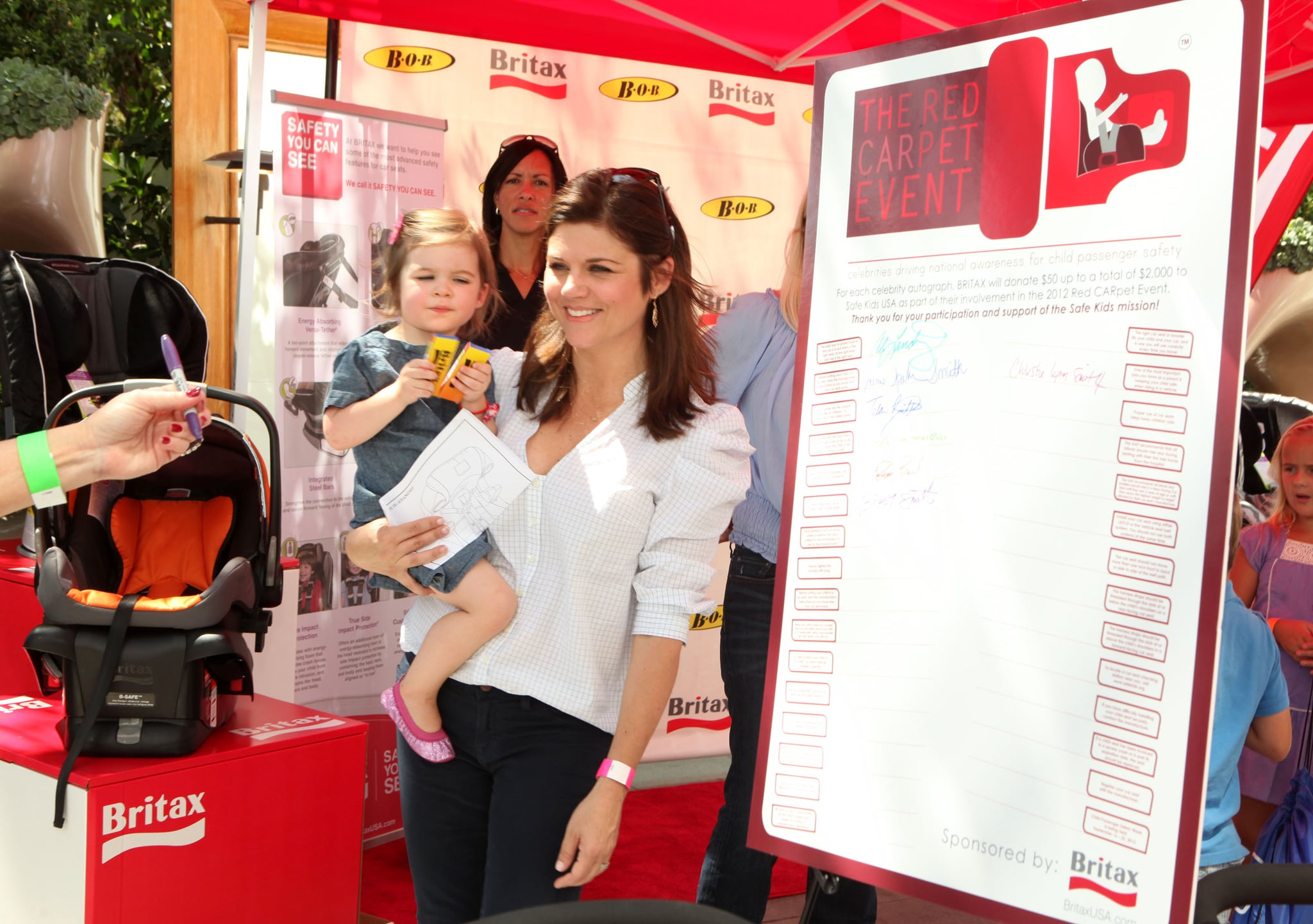 Tiffani Thiessen attended the second annual Red CARpet Event with her daughter, Harper Renn Smith, and learned about proper car seat installation.