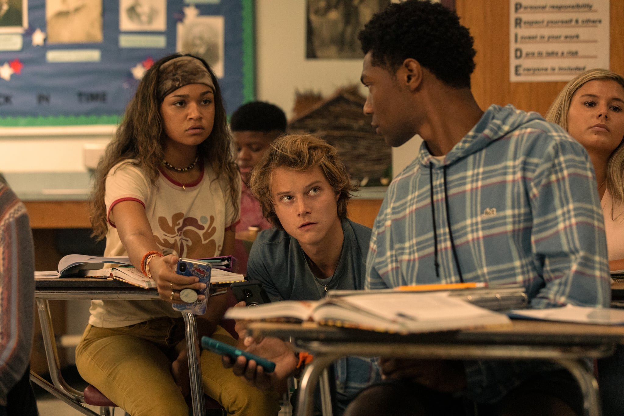 OUTER BANKS (L to R) MADISON BAILEY as KIARA, RUDY PANKOW as JJ and JONATHAN DAVISS as POPE in episode 201 of OUTER BANKS Cr. JACKSON LEE DAVIS/NETFLIX  2021