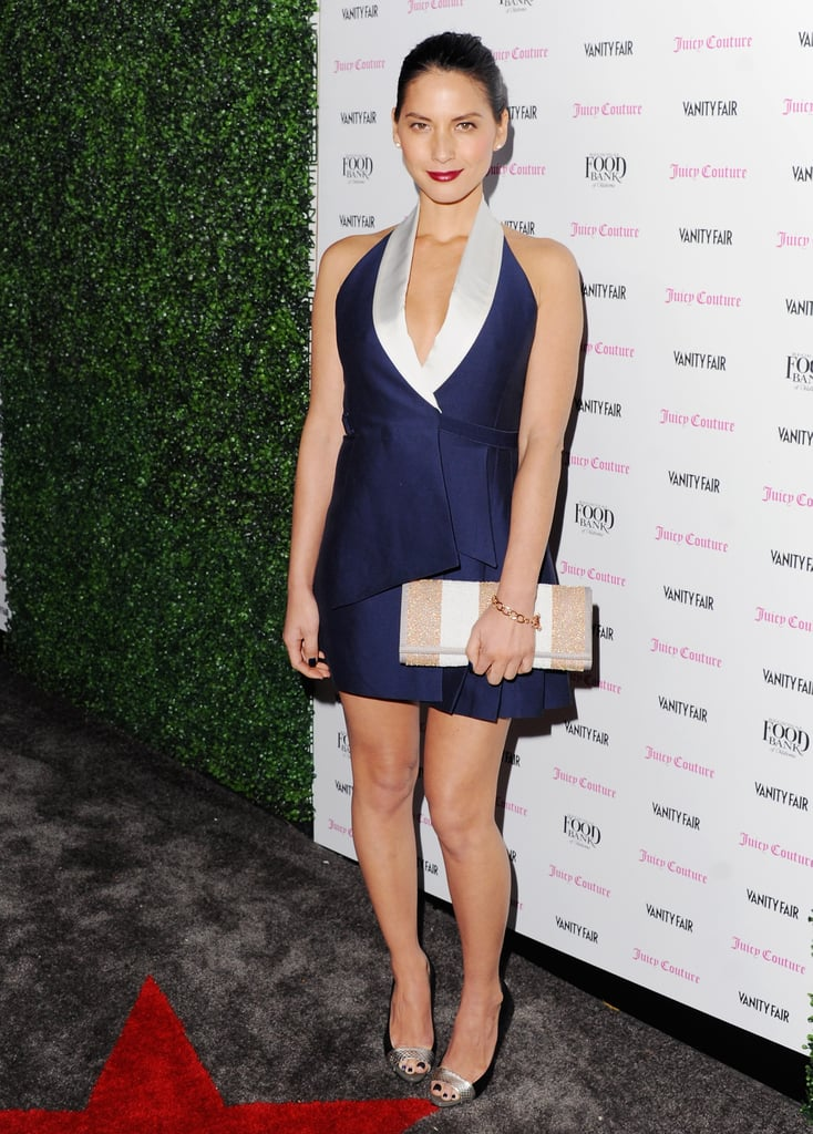 Olivia Munn, who also hosted the party, went with a cocktail-perfect Bird dress — we're loving the nod to sleek tuxedo dressing. She finished off her minidress look with Juicy Couture jewellery, a Juicy Couture striped clutch, and Jean-Michel Cazabat peep-toe pumps.