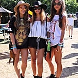 The smartest festival-going friends coordinate. We love how these ladies mixed graphic tees, wide-brimmed ASOS hats, and Frye boots.