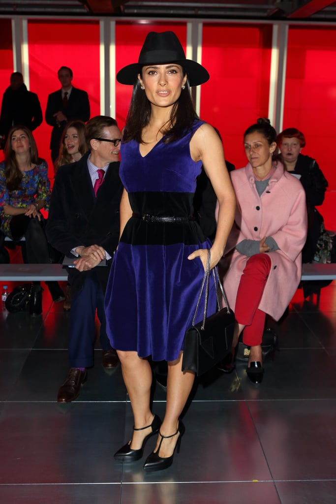 Salma Hayek paired a blue velvet Christopher Kane dress with a wide-brim hat, and t-strap pumps at the designer's show.