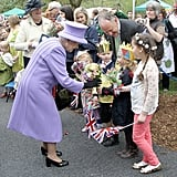 Queen Elizabeth II was given flowers during her visit to Nine Springs Park.