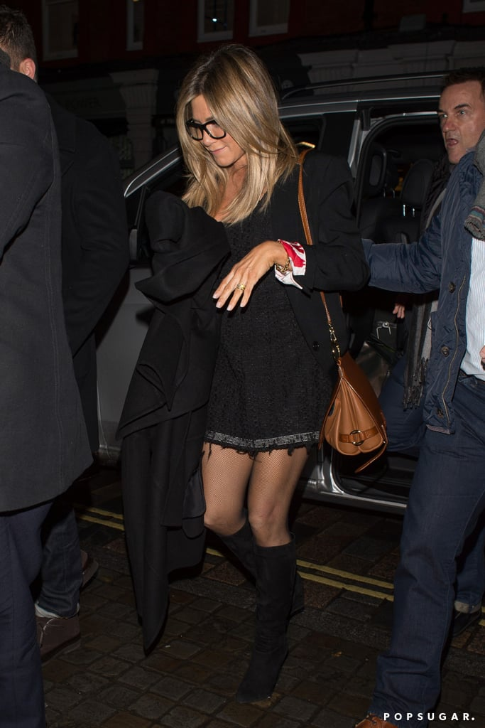 Showing Off Her Toned Legs in a Black Dress and Knee-High Boots