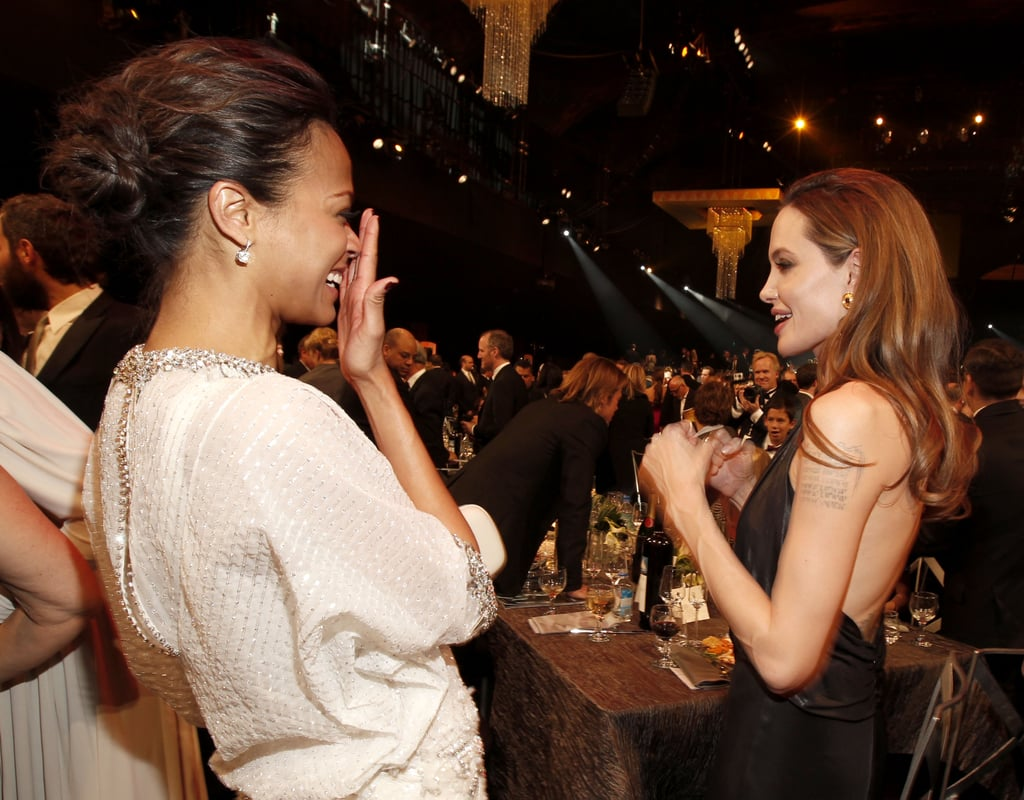 Angelina laughed alongside Zoe Saldana.