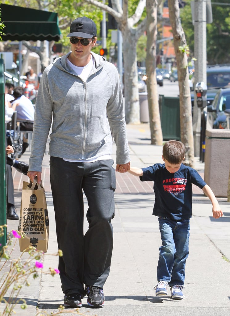 Tom Brady stopped by Whole Foods in Brentwood today with his oldest son, Jack. The guys held hands leaving the grocery store and headed back to their car. Jack was proudly sporting a navy Patriots t-shirt while Tom stuck with shades of gray for their midday outing.  The Brady-Bundchen family's spending the off-season on the West Coast while they settle into their new multimillion-dollar mansion. Gisele was spotted browsing through antiques last month, and with a reported eight bedrooms to decorate she could be busy for some time. Tom's been spending his time off the field with loved ones, while his Super Bowl rival, Eli Manning, has been soaking up the sun in Miami with his daughter, Ava, and wife Abby.