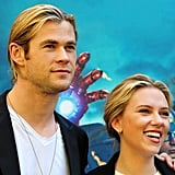 Chris Hemsworth put his hand on Scarlett Johansson's shoulder.