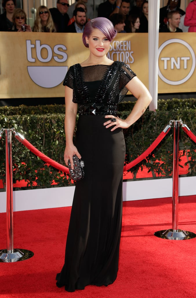 Kelly Osbourne kept it sleek in a black Jenny Packham gown. The sheer stud-embellished bodice — talk about seriously edgy! — complemented the crystal-studded Marchesa clutch and Kelly McDonald jewels.