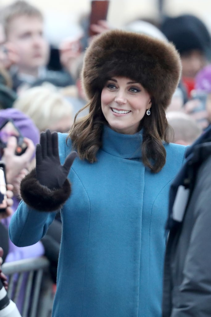 It's pregnancy number three for Kate Middleton, which means she's serving up a slew of swoon-worthy maternity looks. On the current royal tour of Sweden and Norway, the Duchess of Cambridge appears to be feeling blue — the hue, that is: she's been spotted more than once in the shade, this time by way of a sleek cerulean Catherine Walker coat.  Also back for a repeat appearance? Her Lacorine fuzzy brown hat, which is pretty much the ideal accessory for keeping warm while touring through snowy Scandinavian weather. The chocolate brown style is one she's sported back home in London, so it appears this is one trusty accessory. It also matches perfectly with her Cornelia James gloves. If you're feeling the regal vibe (raises hand), we've shopped out the exact piece for you, as well as some additional options, ahead.      Related:                                                                                                           Kate Middleton's Surprising Hat Choice Will Make You Want to Book a Ski Trip ASAP