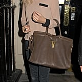 She toted a gorgeous YSL bag while walking in London in 2011.