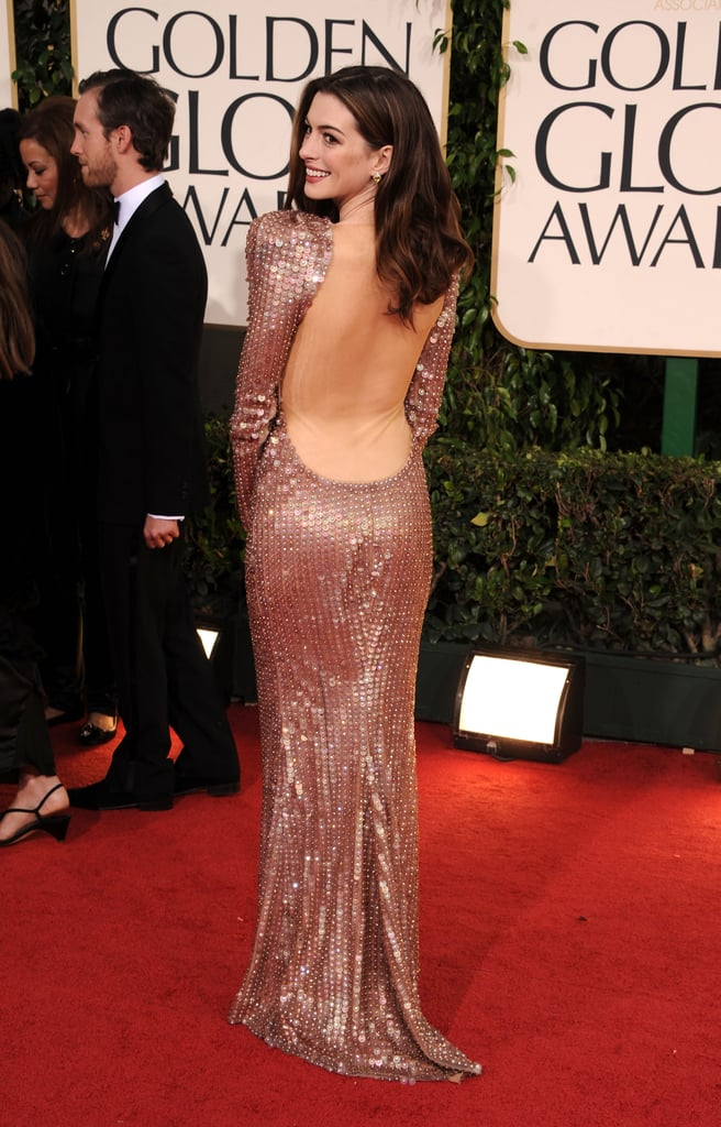 Anne Hathaway showed some skin in her low-backed Armani gown at last night's Golden Globes. She hit the red carpet with boyfriend Adam Shulman, after getting decked out with her stylist Rachel Zoe! Anne is making the award season rounds prepping for her upcoming stint hosting the Oscars —we caught up with her fellow emcee James Franco this weekend and he said their practices are going well! Weigh in on Anne's and other looks tonight with Fab and Bella's love it or hate it polls!