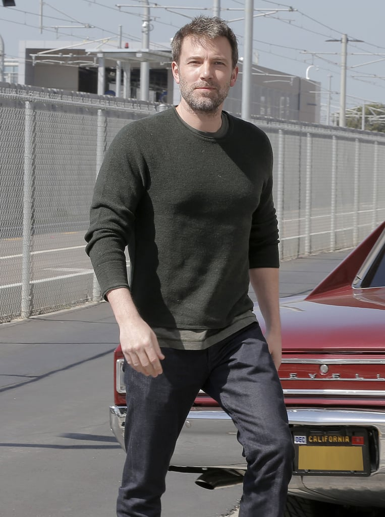 "Ben Affleck was spotted heading to an office building in LA on Friday, showing off his signature smirk and a substantial amount of gray hair — has he officially entered silver fox territory? The actor, who has reportedly written his own Batman script, looked totally at ease while stepping out of his classic Chevy and giving a casual smile to photographers. A pretty far cry from ""Sad Ben Affleck,"" right? Keep reading to see Ben's latest LA outing, then check out more famous, sexy silver foxes."