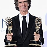 Game Change director Jay Roach held up his Emmys at the show.