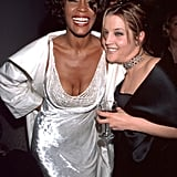 Whitney enjoys herself with Lisa Marie Presley in 1999.