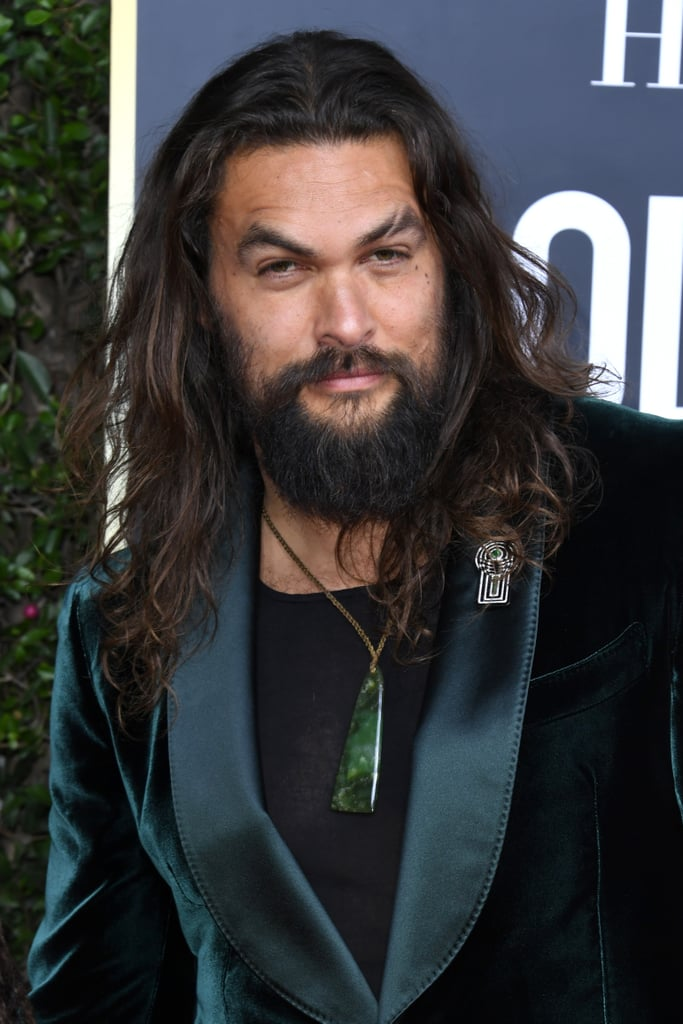 Jason Momoa put his muscles on full display as he attended the Golden Globes on Sunday night. After hitting the red carpet with wife Lisa Bonet, the actor didn't waste any time shedding his dapper green blazer inside the event. During the show, Jason and his bulging biceps were spotted in the crowd as he wore a blank tank top with his hair pulled back in a ponytail. Because who says you have to wait until after the show to shed your clothes and wear comfy clothes? Naturally, people are completely loving the moment on Twitter. See some of the best reactions to Jason and his tank top ahead.