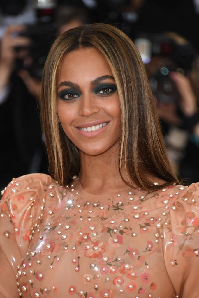 Beyoncé surprised us with a dramatic look as we long awaited her appearance at the 2016 Met Gala. She switched up her usual neutral and metallic eye shadows by pairing her latex-like Givenchy dress with a heavy smokey eye. Leave it to the Queen to pull this off! Beyoncé also sported a center part and bum-skimming sleek hair.    While we admire the Lemonade singer's more toned-down makeup, we love how she played it up for the red carpet on Monday. Maybe bold album equals bold eye? Either way, there's no doubt she slays. Keep scrolling to see more photos!