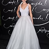 When she arrived at the Mother! premiere in NYC on Sept. 13, 2017, Maria Grazia Chiuri's custom white Dior gown reminded us of a wedding dress. She completed the ensemble with Lorraine Schwartz jewels.