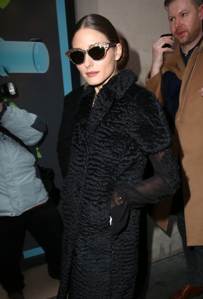Olivia Palermo capped off her all-black ensemble with dramatic cat-eye shades on her way to Rochas.