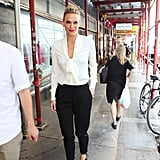 Molly Sims arrived for Rachel Zoe's presentation during NY Fashion Week.