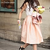 A full soft petal-pink skirt was the perfect ladylike counter for modern, snake-print heels.