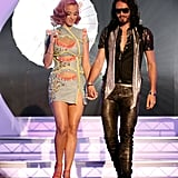 Katy Perry and Russell Brand walk hand in hand.